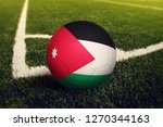 Small photo of Jordan ball on corner kick position, soccer field background. National football theme on green grass.