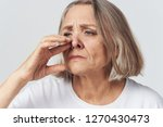Small photo of Woman's stuffy nose, poor health of an elderly woman