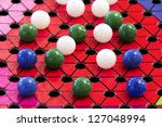 A Chinese Checkers Board And...