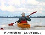 Rear View Of Kayaker Man Paddle ...
