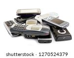 old mobile phones in a pile on... | Shutterstock . vector #1270524379