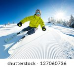 skier on piste in high mountains | Shutterstock . vector #127060736