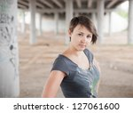 young brunette posing in the... | Shutterstock . vector #127061600