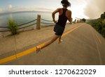 fitness woman running on... | Shutterstock . vector #1270622029