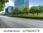 empty asphalt road near glass... | Shutterstock . vector #1270634173