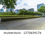 empty asphalt road near glass...   Shutterstock . vector #1270634176