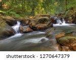landscape photo view waterfall... | Shutterstock . vector #1270647379