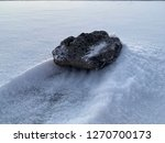 volcanic rock on snow in icy... | Shutterstock . vector #1270700173