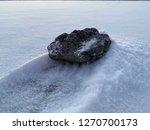 volcanic rock on snow in icy... | Shutterstock . vector #1270700173