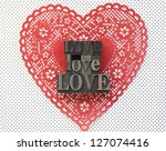 the word 'love' in old metal... | Shutterstock . vector #127074416