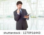 businessman using touch pad of...   Shutterstock . vector #1270916443