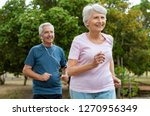 senior couple running outside... | Shutterstock . vector #1270956349