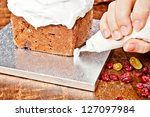 Decorating cake with a pastry bag full of cream - stock photo