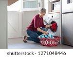 happy senior woman loading... | Shutterstock . vector #1271048446