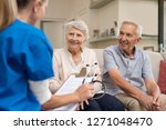 nurse during home visit with... | Shutterstock . vector #1271048470