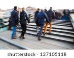 people in motion blur crossing the pedestrian bridge Ponte dell Accademia in Venice - stock photo