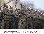 Bucharest, Romania - December 1, 2018: Polish soldiers with cameras on helmets and armed with Beryl assault rifles (holographic sights, vertical foregrips) at the Romanian National Day military parade - stock photo