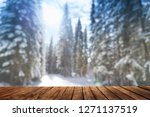 wooden table and winter forest... | Shutterstock . vector #1271137519