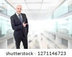 happy business man pointing  at ...   Shutterstock . vector #1271146723