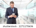 young business man on the phone ...   Shutterstock . vector #1271170636