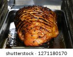 slow roasted gammon in the oven | Shutterstock . vector #1271180170