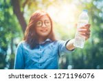 in hot weather  strong sun and... | Shutterstock . vector #1271196076