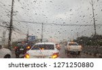 drive on the road with rain...   Shutterstock . vector #1271250880
