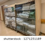 two carts with bedding linens... | Shutterstock . vector #1271251189