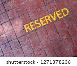 reserved text on a cement tile... | Shutterstock . vector #1271378236