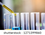 using dropper sampling oil or... | Shutterstock . vector #1271399860
