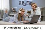 teenager in headphones ignoring ... | Shutterstock . vector #1271400346