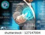 a man touching a button on a... | Shutterstock . vector #127147004