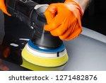 car polish wax worker hands... | Shutterstock . vector #1271482876