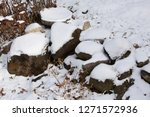 Snow Covered Rocks In A...