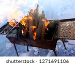 brazier with burning wood in... | Shutterstock . vector #1271691106