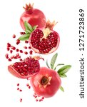 Small photo of Flying in air fresh ripe whole and cut pomegranate with seeds and leaves isolated on white background. High resolution image