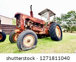 Rusty Old Tractor With A Flat...
