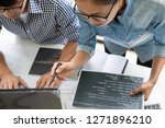 programmer working in a... | Shutterstock . vector #1271896210
