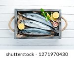 Stock photo mackerel on a white wooden background raw fish top view free copy space 1271970430