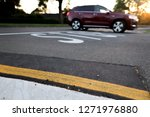 unfocused red car turning at...   Shutterstock . vector #1271976880
