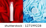Arty collage of photos of beauty cream box and spray (aerosol) over turquoise (blue) and red vapory and wavy cloth background. studio shot - stock photo