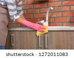 woman cleaning kitchen counter... | Shutterstock . vector #1272011083
