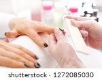 removal of hybrid varnish with... | Shutterstock . vector #1272085030