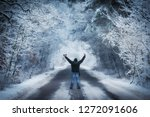 man on the winters road a snowy ... | Shutterstock . vector #1272091606