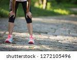 tired female runner taking a... | Shutterstock . vector #1272105496