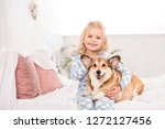 smiling child in pajamas... | Shutterstock . vector #1272127456