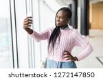 young african woman take selfie ...   Shutterstock . vector #1272147850
