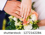hands of a bride and a groom... | Shutterstock . vector #1272162286