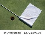 golf field with empty hole and... | Shutterstock . vector #1272189106