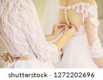 young bride in a white gown.... | Shutterstock . vector #1272202696